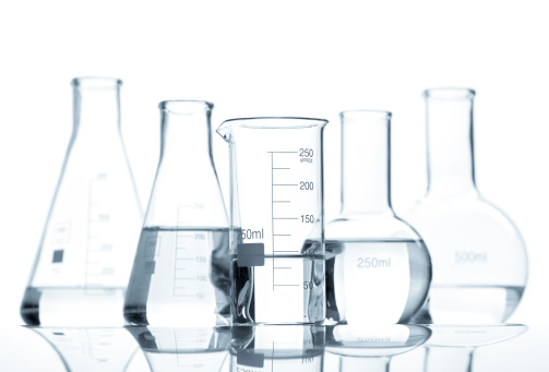Five laboratory flasks with a clear liquid Allantoin